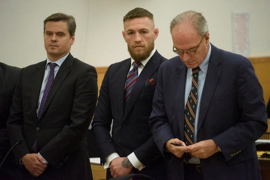 McGregor (centre) pleads guilty to disorderly conduct during a hearing at the New York State Supreme Court.