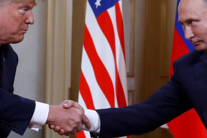 Trump (left) and Putin shake hands as they meet in Helsinki, Finland.
