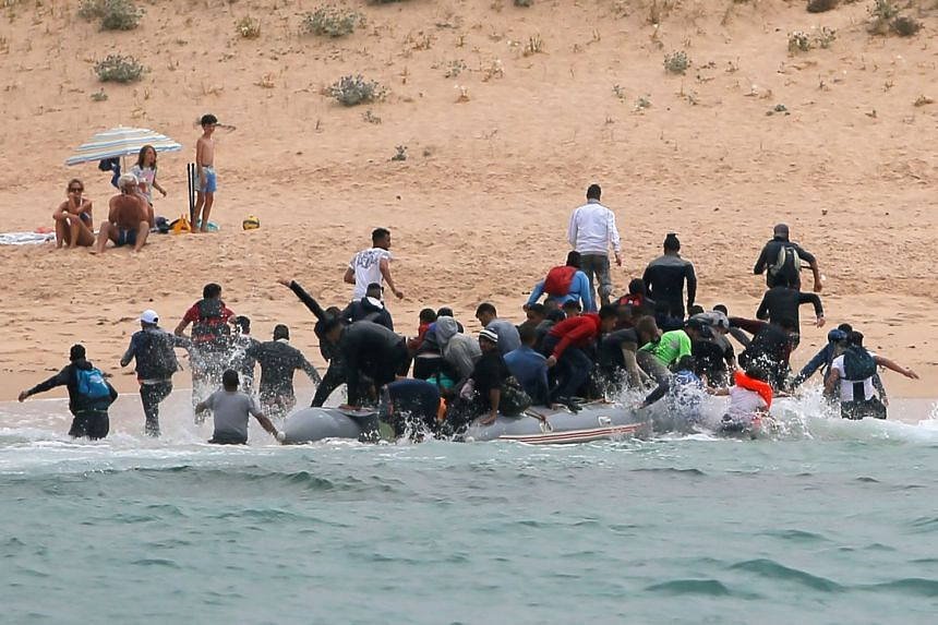 The migrants fled after landing on the beach in Tarifa, Spain.