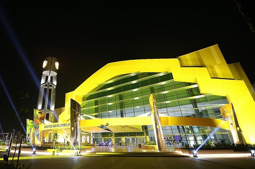 DC Comics characters on stage during the official opening of the Warner Bros World theme park on Yas Island in Abu Dhabi. The complex (above left), which opened to the public on Wednesday, boasts 29 rides and six themed areas - including the fictiona