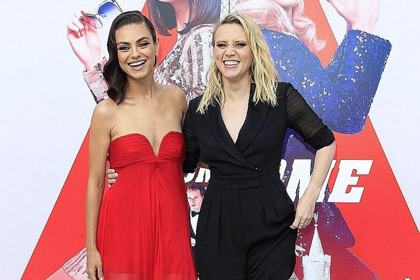 American actresses Mila Kunis (left) and Kate McKinnon attend the world premiere of The Spy Who Dumped Me at the Regency Village Theater in Westwood, Los Angeles, on Wednesday. In the movie, two best friends, played by Kunis and McKinnon, become invo