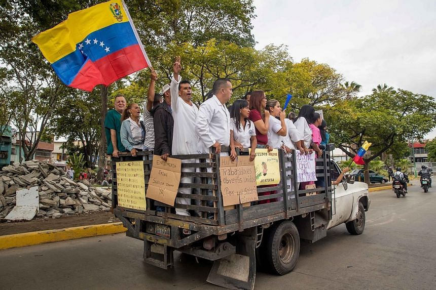 Health workers in Caracas on Wednesday protesting to demand higher salaries. President Nicolas Maduro on Wednesday said five zeroes will be removed from the bolivar. The new bolivar bills will be in circulation next month .