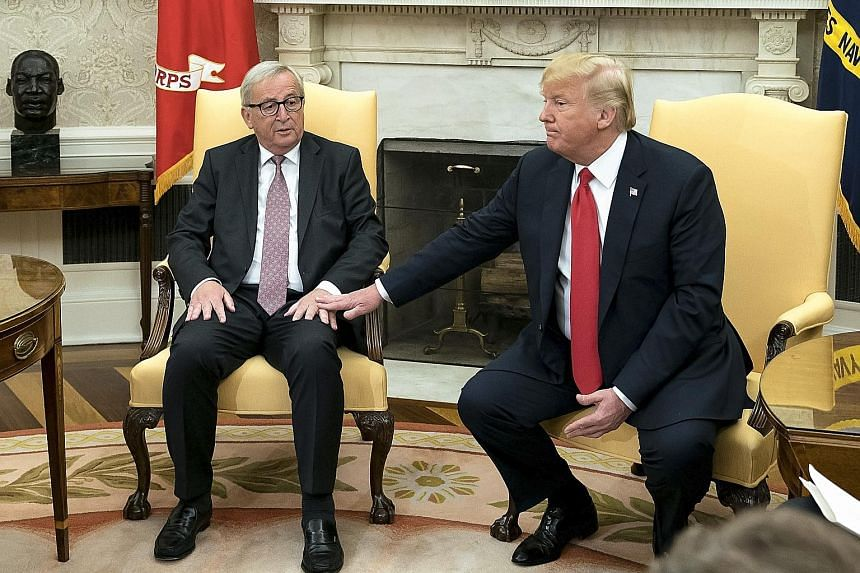 European Commission President Jean-Claude Juncker (left) with US President Donald Trump at the White House on Wednesday. Mr Trump has announced trade concessions from the European Union.