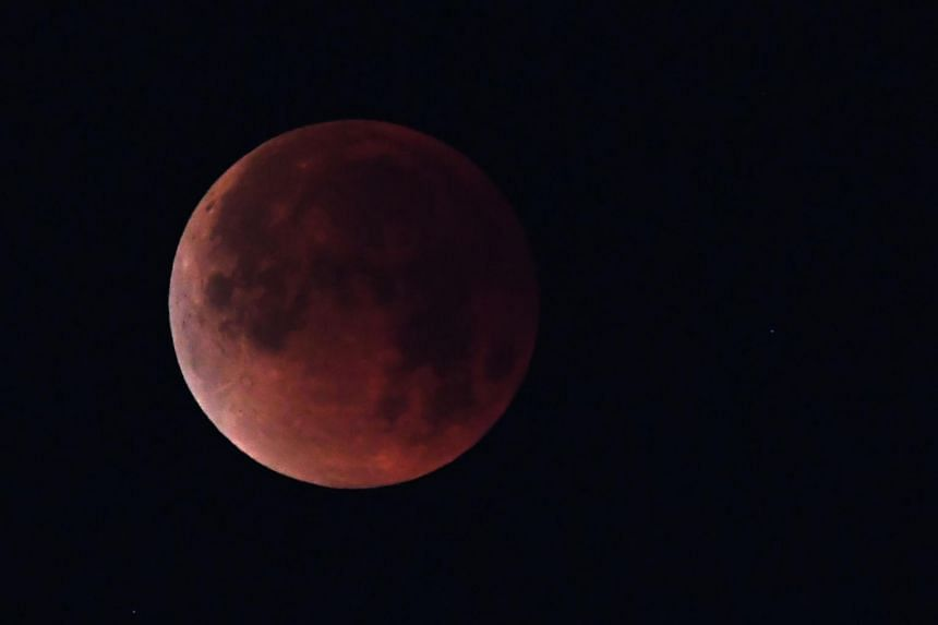 "Coinciding with Mars' closest approach in 15 years, the longest ""blood moon"" eclipse of this century will offer skygazers, who will need no protective eye gear, a thrilling astronomical double bill."