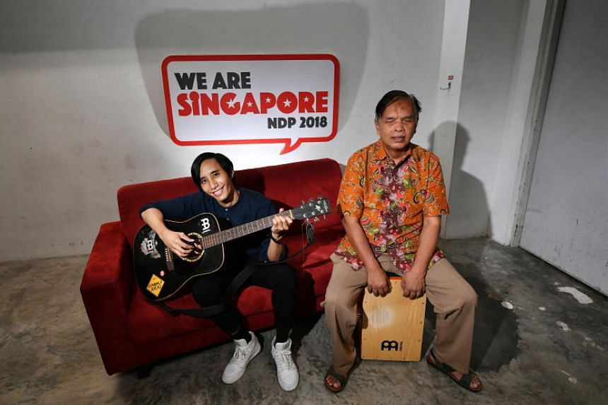 Father-son busking duo Mashruddin Saharuddin (right) and his son Nizaruddin (left) are among the protagonists featured in a series of films that will be played throughout the National Day Parade show.