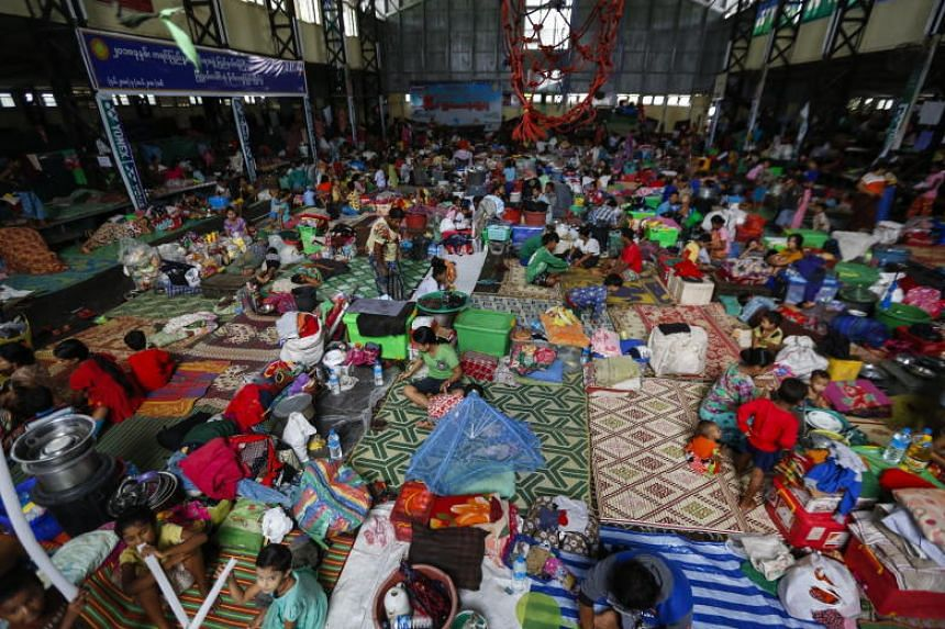Residents take shelter inside a sport centre turned temporary evacuation center at Hpa-An Township in Kayin State, Myanmar, on July 24, 2018.