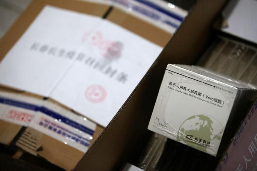 A box of vials containing the rabies vaccine manufactured by vaccine maker Changsheng Biotechnology is seen next to a sealed package of the same vaccines to be recalled at a local disease prevention and control centre in Huangshan, China, on July 23,