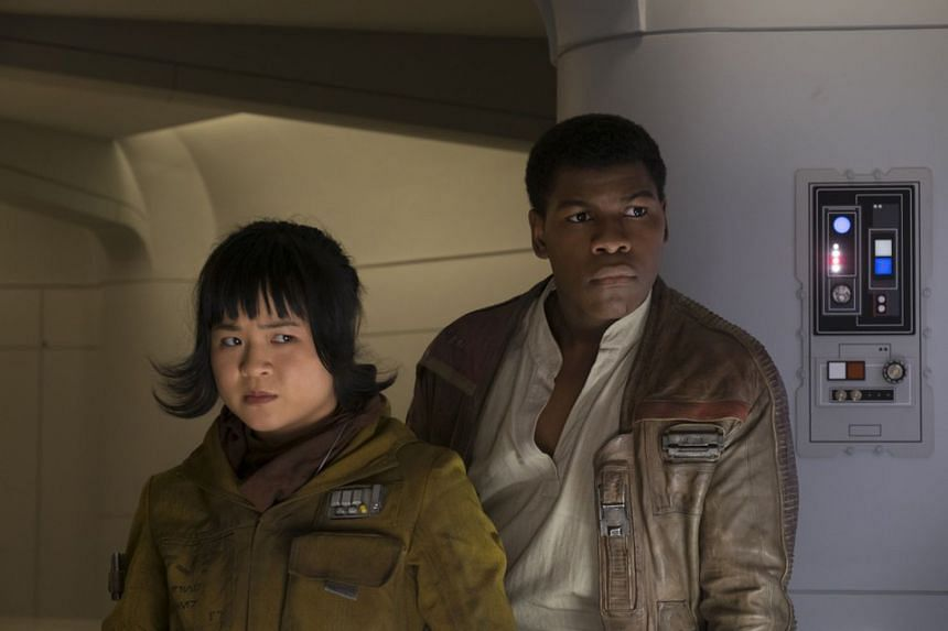 Kelly Marie Tran (playing Rose Tico) starring opposite John Boyega (as Finn) in Star Wars: The Last Jedi.