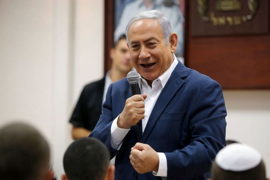 PM Netanyahu adressing a group of conscripts at a military recruitment centre near Tel Aviv on July 26, 2018.