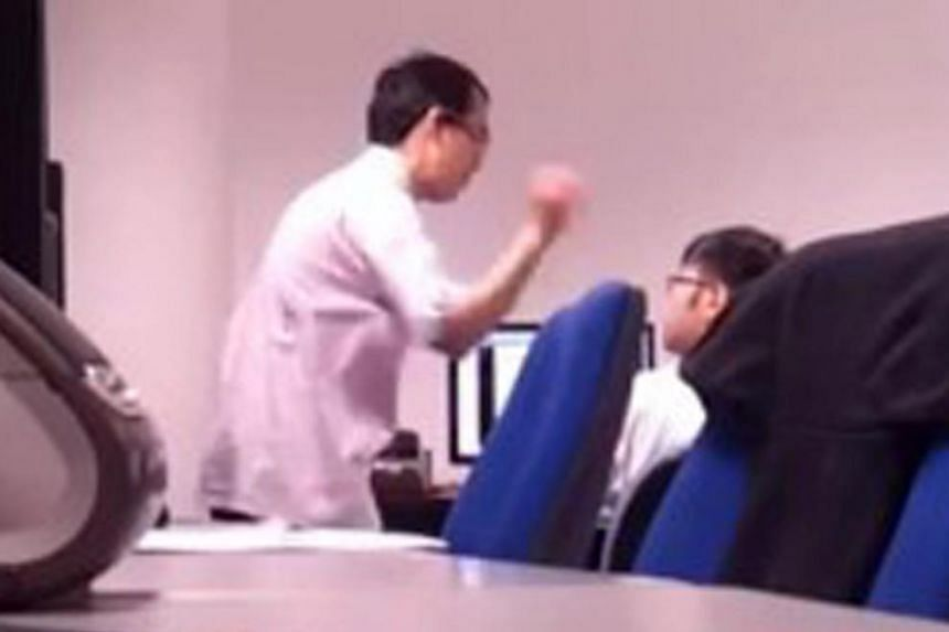 A screengrab of IT company manager Lee Yew Nam hitting his intern in a 2013 case. The abuse was recorded by another intern, who uploaded the clip on the YouTube website, triggering a public uproar.