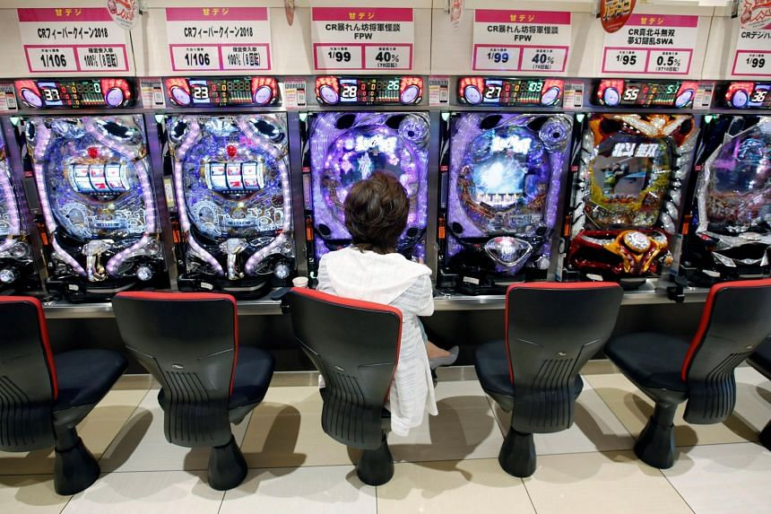 A visitor playing pachinko, a Japanese form of legal gambling in which pachinko enthusiasts are often ready to spend 100,000 yen in just one visit, compared to around 10,000 yen to 20,000 yen years ago.