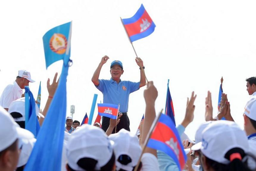 Cambodia's Prime Minister Hun Sen and leader of the ruling Cambodian People's Party wave to supporters during the final campaign rally in Phnom Penh, on July 27, 2018.