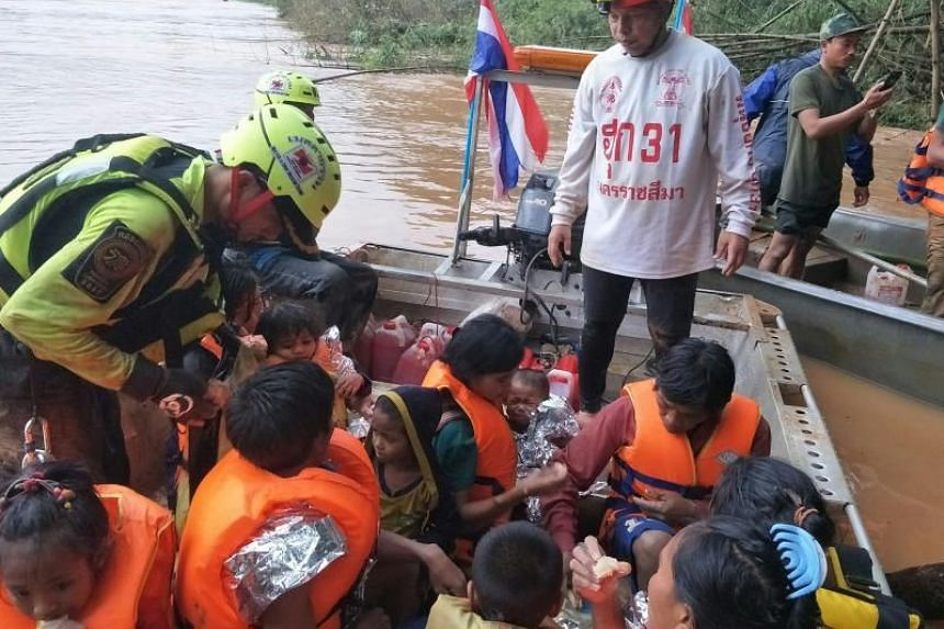 A Thai Rescue Team volunteer group rescuing flood survivors, including a baby trapped in a remote village, close to the swollen river in Attapeu province on July 26, 2018.