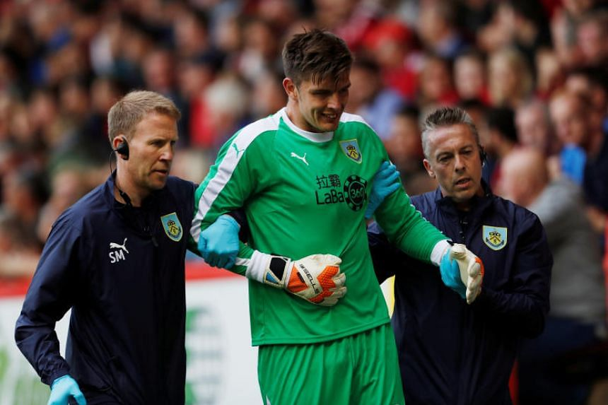 Burnley's Nick Pope being substituted after sustaining an injury during the Europa League match against Aberdeen on July 26, 2018.