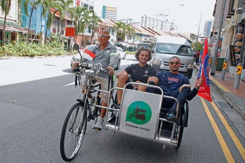 Paris Saint-Germain players riding down Serangoon Road in Little India with Singapore's Trishaw Uncle.