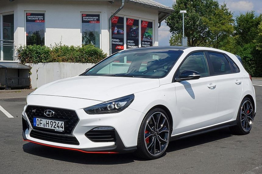 The Hyundai i30N hatchback (right) is lively and a little aggressive, with a hint of torque steer. A prototype of the Hyundai i30N Fastback (above), which will be unveiled in November.