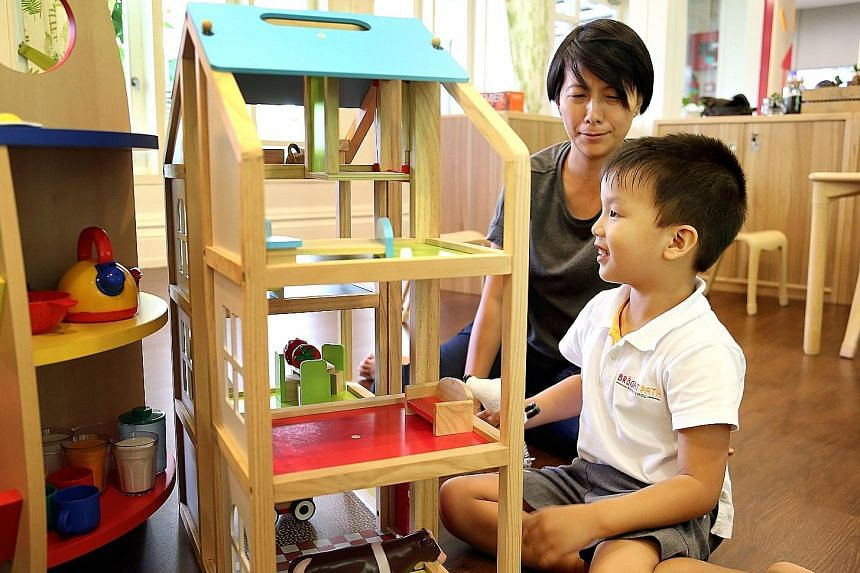 Ms Foo Wann Yun (above) with her 41/2-year-old son Russell, who has autism, at Bright Path Preschool. The pre-school offering inclusive education helps children develop their gross motor skills with a sensory path and its maths lessons include water play.