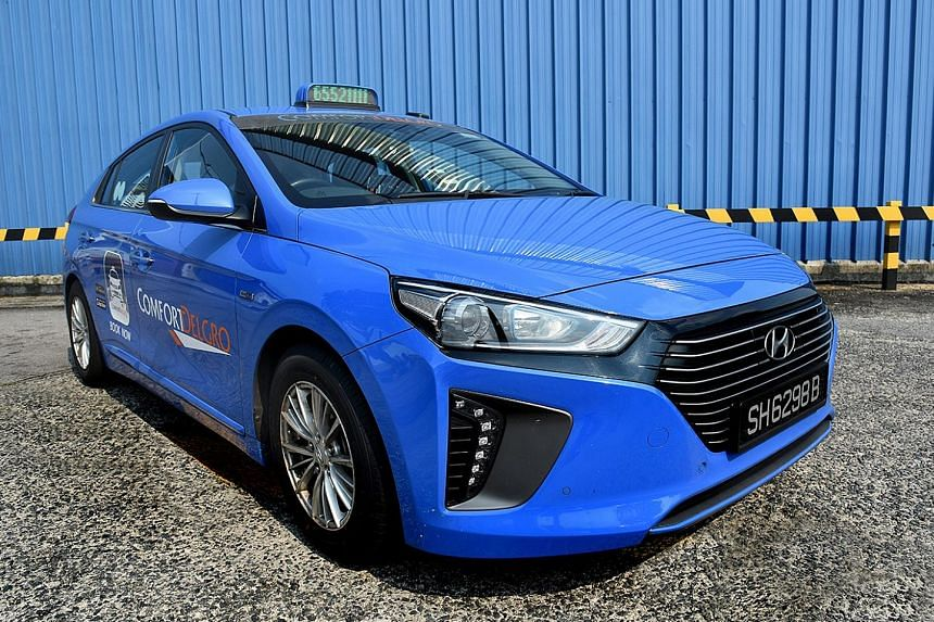 ComfortDelGro's new Hyundai Ioniq Hybrid taxi. Last week, the dominant taxi operator put two fully electric Hyundai cabs on the road.