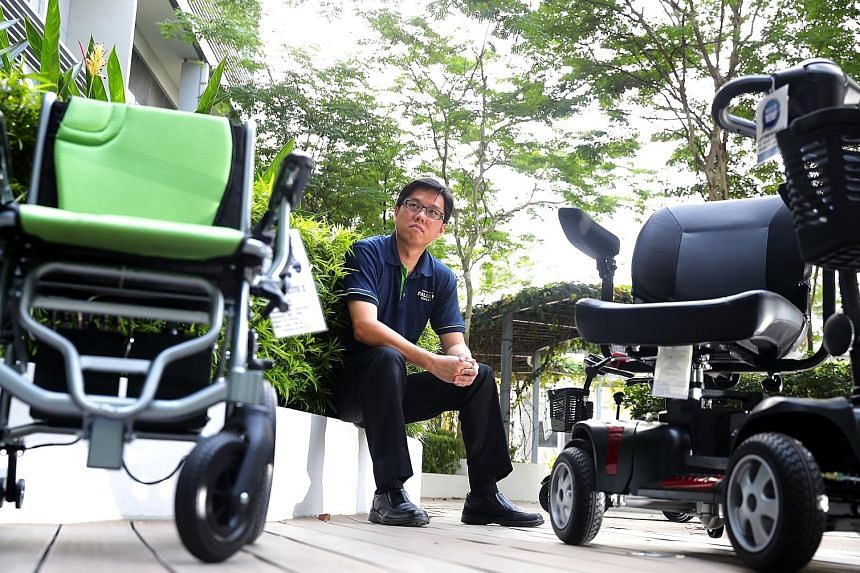 Mr Warren Chew of Falcon Mobility with some of the motorised wheelchairs and mobility scooters typically available for disabled and elderly users here.