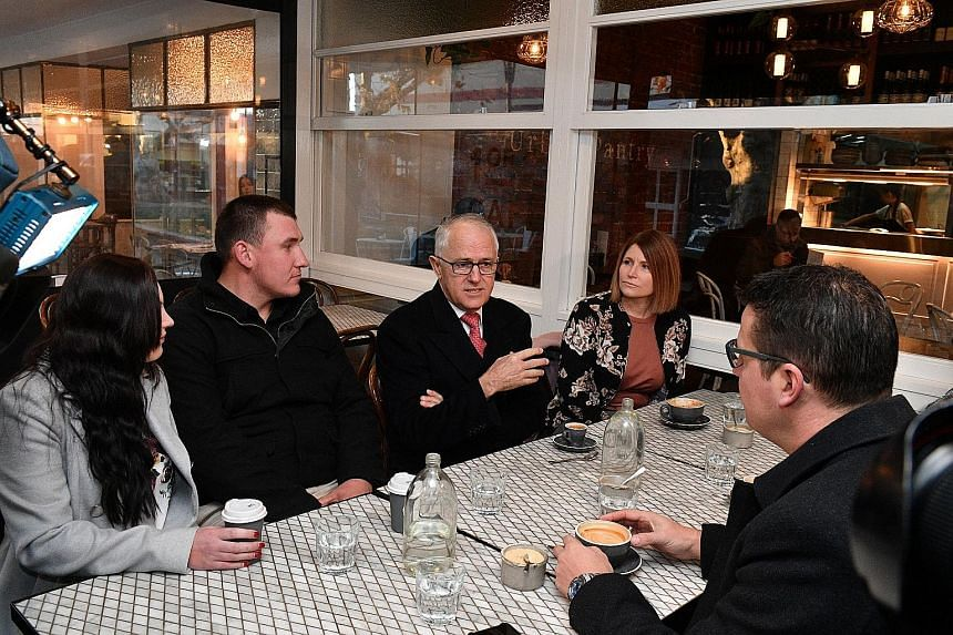 Australian Prime Minister Malcolm Turnbull visiting a cafe in Canberra to speak on his government's income tax cuts last month. His personal popularity is at its highest level in two years, according to the latest opinion poll.