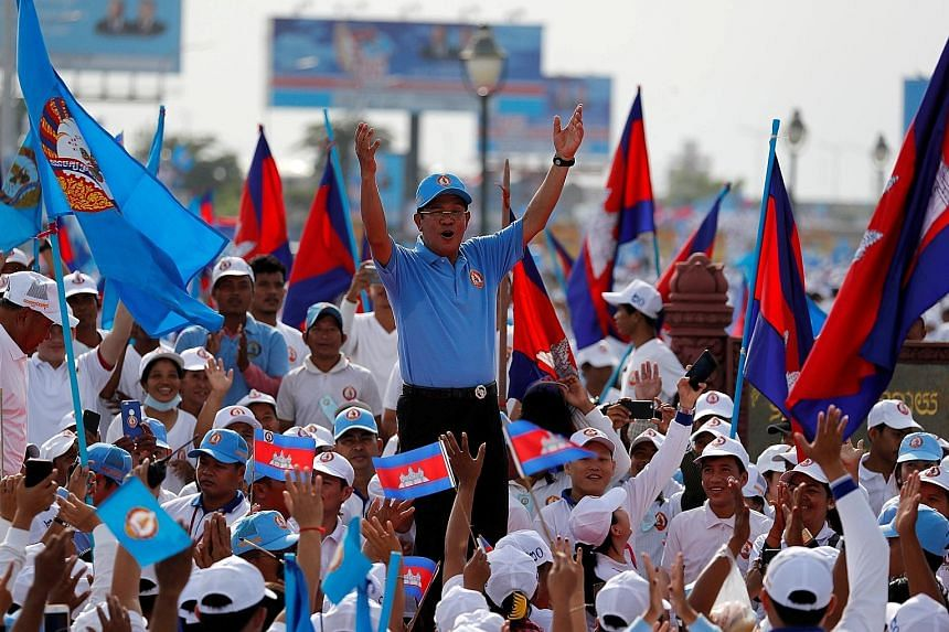 Cambodian Prime Minister Hun Sen at a rally on the final day of campaigning yesterday in Phnom Penh. Mr Hun Sen, who has been premier for over three decades, looks set to win another term in tomorrow's election.