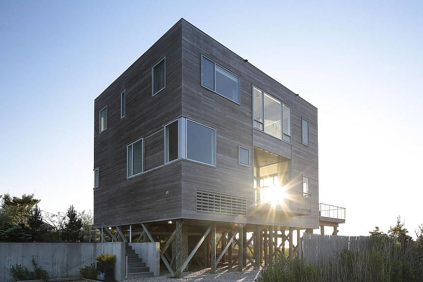 This house (above) in Westhampton Beach, New York, was built to take in the ocean views (left) and provide a bright airy space for a multi-generational family.