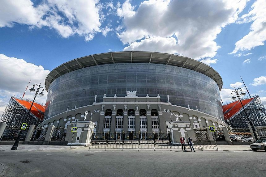 Constructing two additional stands that protrude from openings on either end of Tsentralnyi Stadium (left and below) expanded the arena's capacity to 35,000, from 23,000, while preserving the old lower facade as a base.