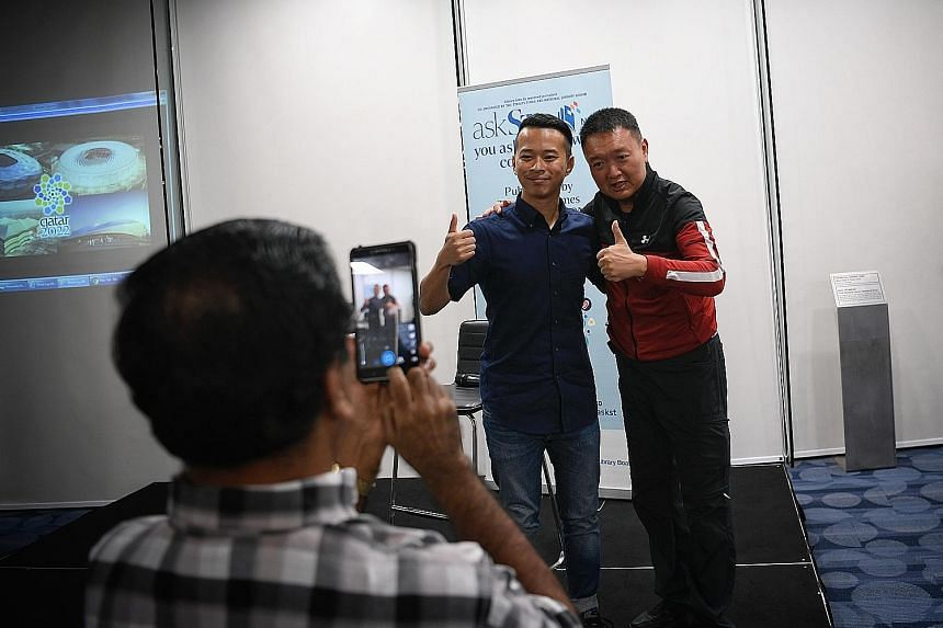 ST sports correspondent David Lee sharing his experiences in Russia with a crowd of 120 at an askST@NLB session and obliging an avid reader with a photograph (above). The 33-year-old spoke about his challenges in operating on numerous platforms under tigh