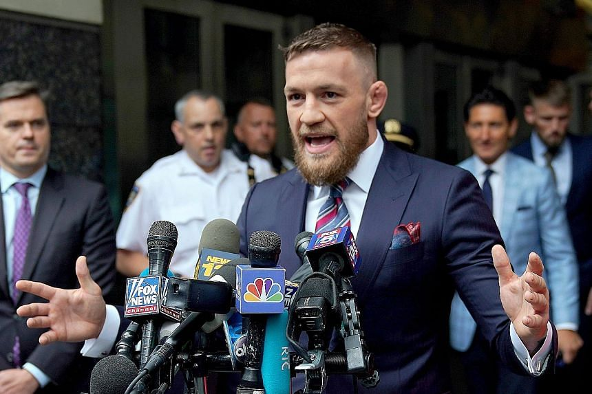 Irish mixed martial arts star Conor McGregor addressing the media after pleading guilty to disorderly conduct in Brooklyn Criminal Court on Thursday. He faced criminal charges after an altercation with other fighters in April.