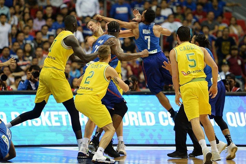 Players from the Philippines and Australia brawling during their World Cup Asian qualifier in Manila on July 2. Australia won 89-53 by default when the hosts had only one player left on court.