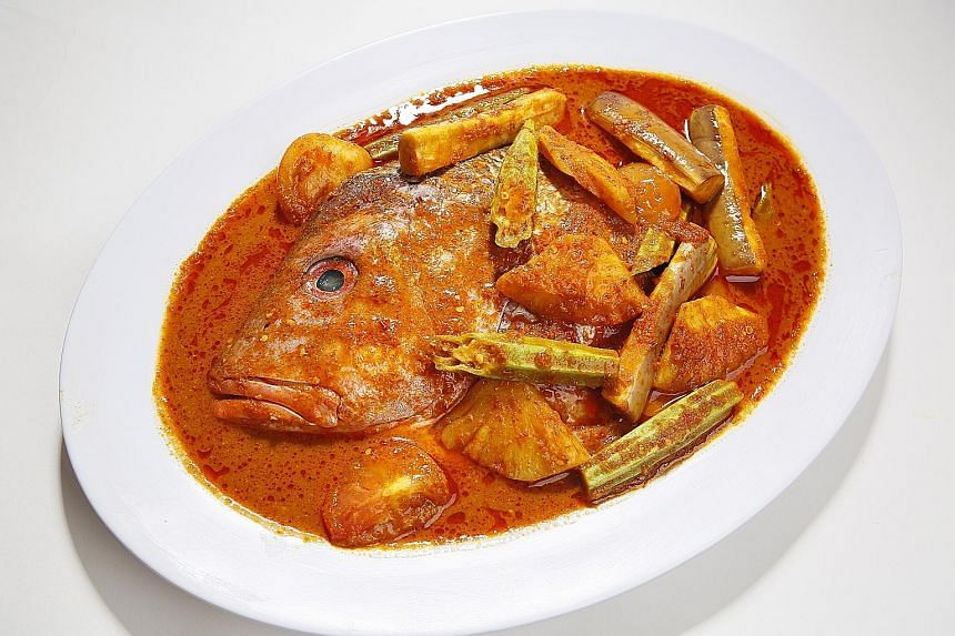 The signature assam fish head that comes with a spicy and sour assam-blend gravy is one of Gu Ma Jia's most popular dishes.