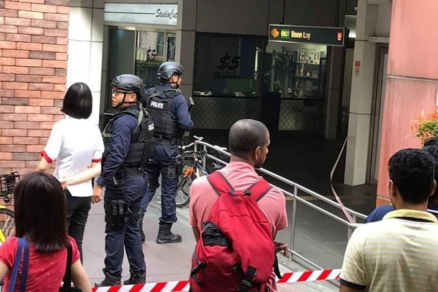 Police officers were directing people to stay away and MRT staff were preventing people from entering the station.
