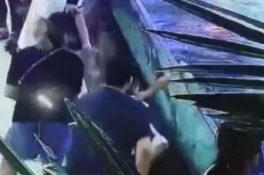 Security footage posted by news sites including Chinese news site CCTV show bystanders rapidly backing away at the time of the attack, while the girl is shown struggling frantically and crouched over on the floor.