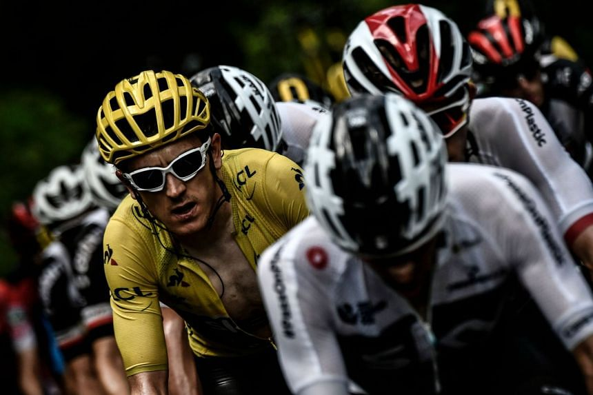 Thomas (left), wearing the overall leader's yellow jersey, rides in a counter attack group during the 19th stage.