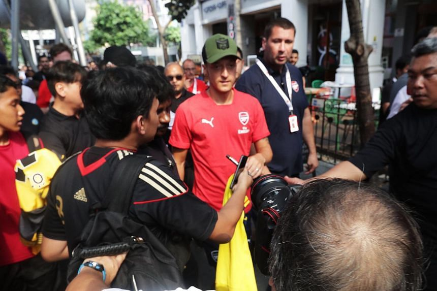 """The biggest crowd favourite, Arsenal player Mesut Ozil (in red) thanked fans for their """"love"""" after a torrid week that saw him announce his retirement from the German Football Association due to perceived racism."""