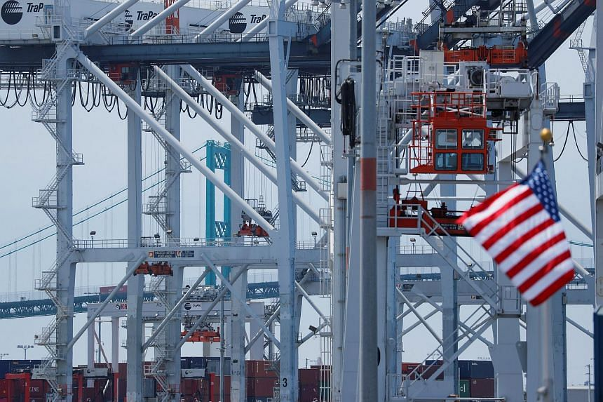 The US flag flies at the Port of Los Angeles in Los Angeles, California, on July 16, 2018.