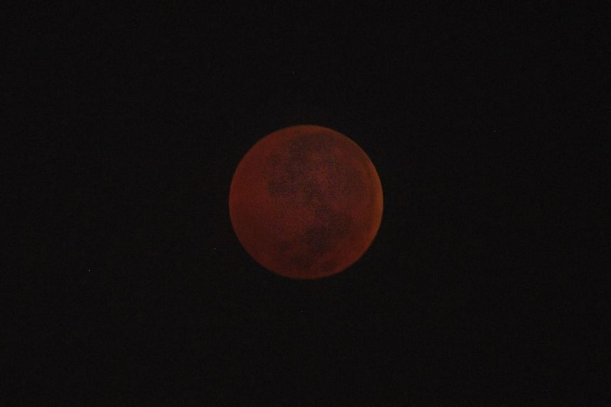 The blood moon at the maximum eclipse at 4.20am on July 28, 2018.