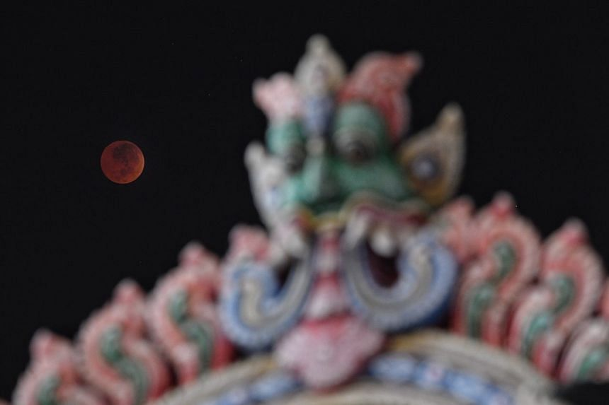 The moon at the maximum eclipse at 4.20am in Singapore, on July 28, 2018.