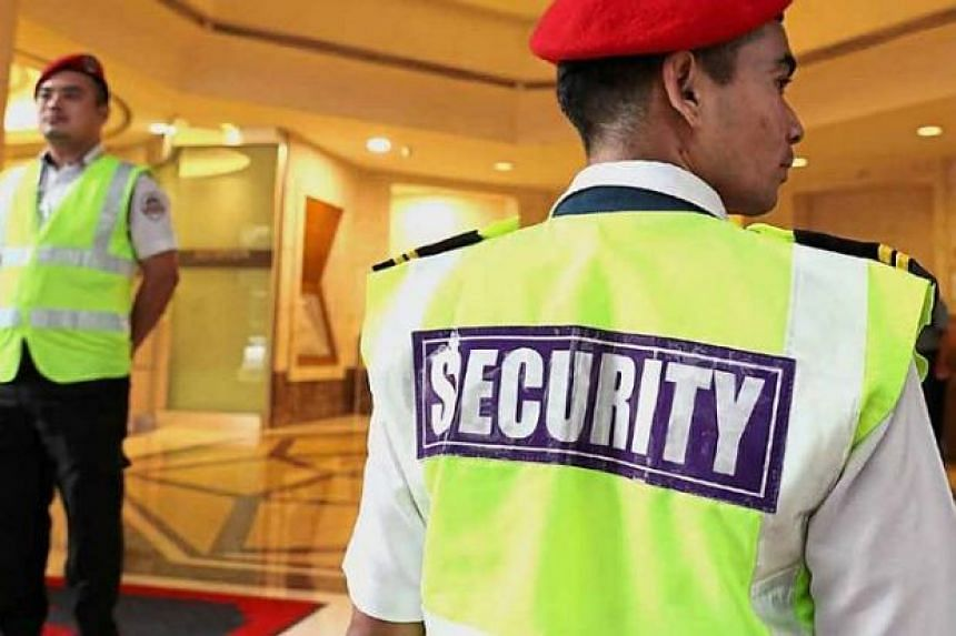 Nepalese security guards patrolling an office building in Petaling Jaya.