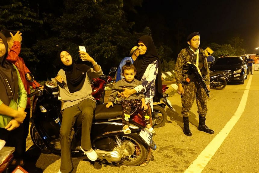 Residents at a recent Hari Raya concert in Betong, desensitised to the deterrent military presence. Officials say the presence of paramilitaries has only strengthened the local economy.