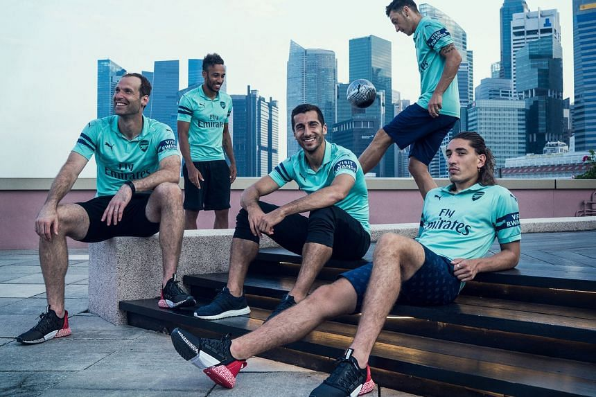 From left: Petr Cech, Pierre-Emerick Aubameyang, Henrikh Mkhitaryan, Mesut Ozil and Hector Bellerin model Arsenal's third kit under Singapore's central business district skyline. The Gunners face French champions Paris Saint-Germain tonight at the Nationa