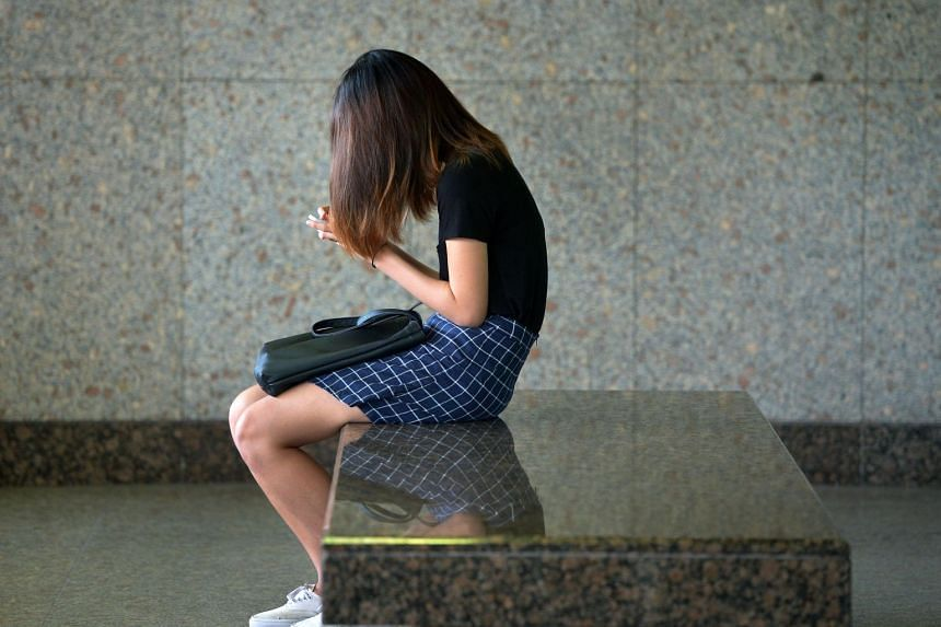 File photo of a woman using her smartphone. The number of patients with cyber wellness issues such as social media addiction is increasing, according to counsellors and psychologists.