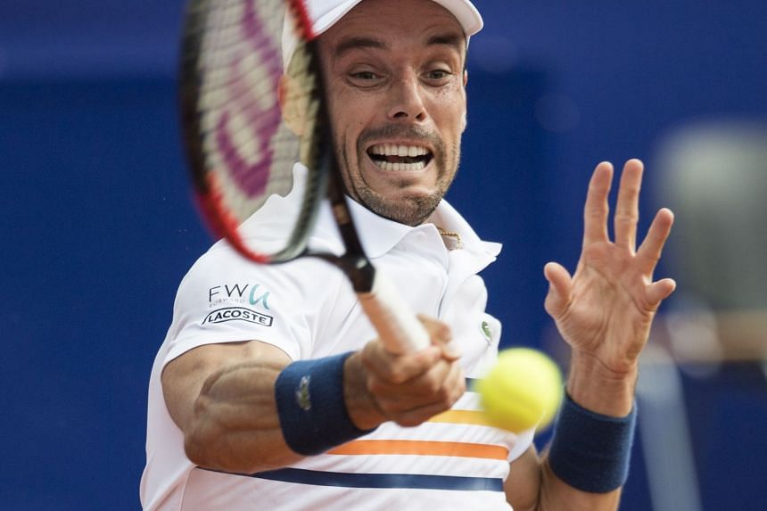 Bautista Agut in action against Laslo Djere of Serbia.