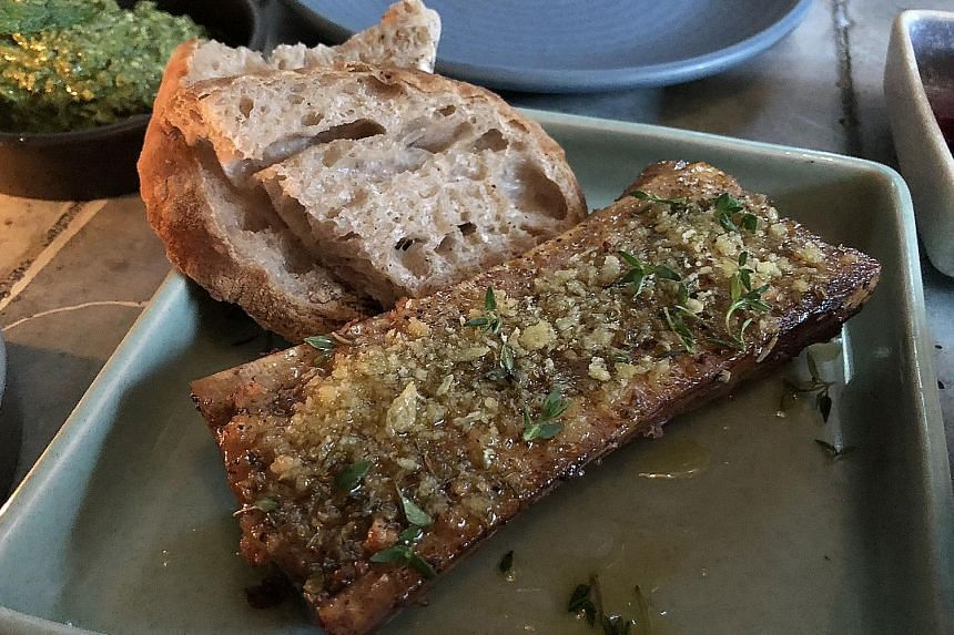 Sideways' bone marrow with a side of sourdough bread.