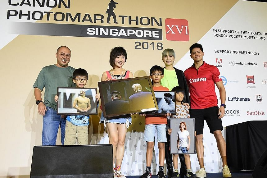 Civil servant Tangie Kay, 42, and her children (from far left) Kenji, nine, Junya, 11, and Nori, seven, holding photos that were bought by Ms Kay's friend as part of the fund-raising efforts. With them are (from far left) Mr Norman Ayob of Canon Sing