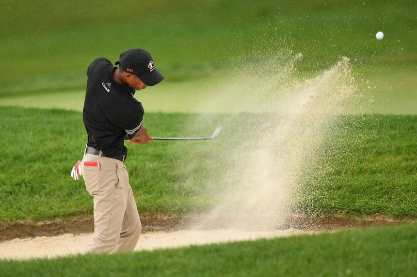 Chris Crisologo plays a shot from a bunker on the fourth hole during the third round at the RBC Canadian Open at Glen Abbey Golf Club in Oakville, July 28, 2018.