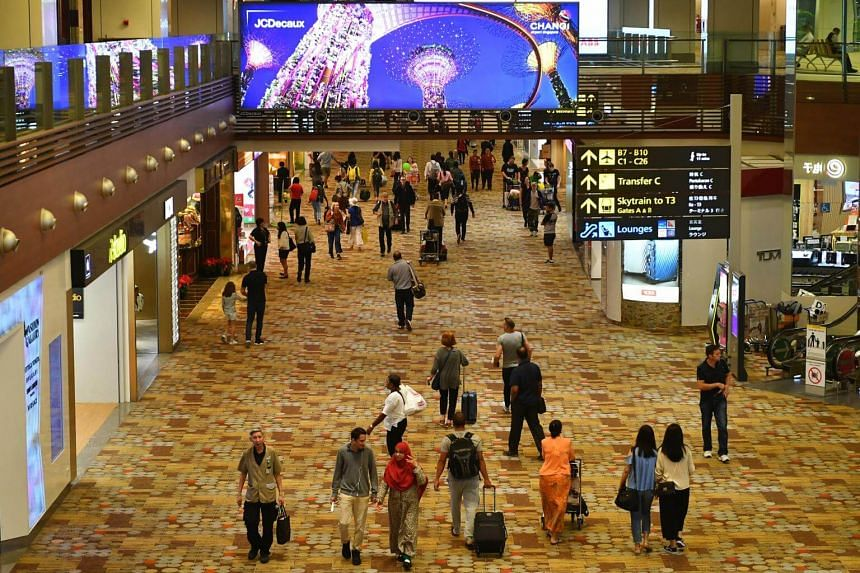 Passengers in the transit area of Changi Airport Terminal 1.