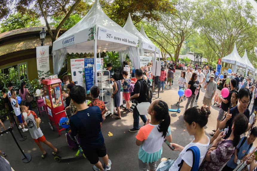Visitors at a mini carnival organised by The Straits Times in the Singapore Botanic Gardens, where The Straits Times Concert in the Gardens will take place in the evening on July 29, 2018.