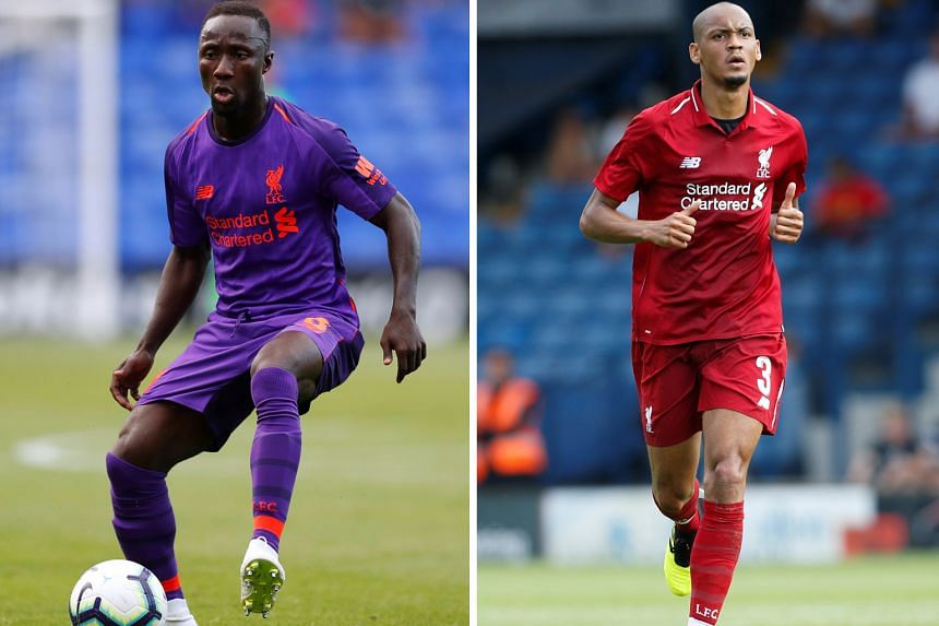 Liverpool have spent heavily this year on transfers, splashing more than £200 million (S$357 million) on signings, including for Naby Keita (left) and Fabinho (right).