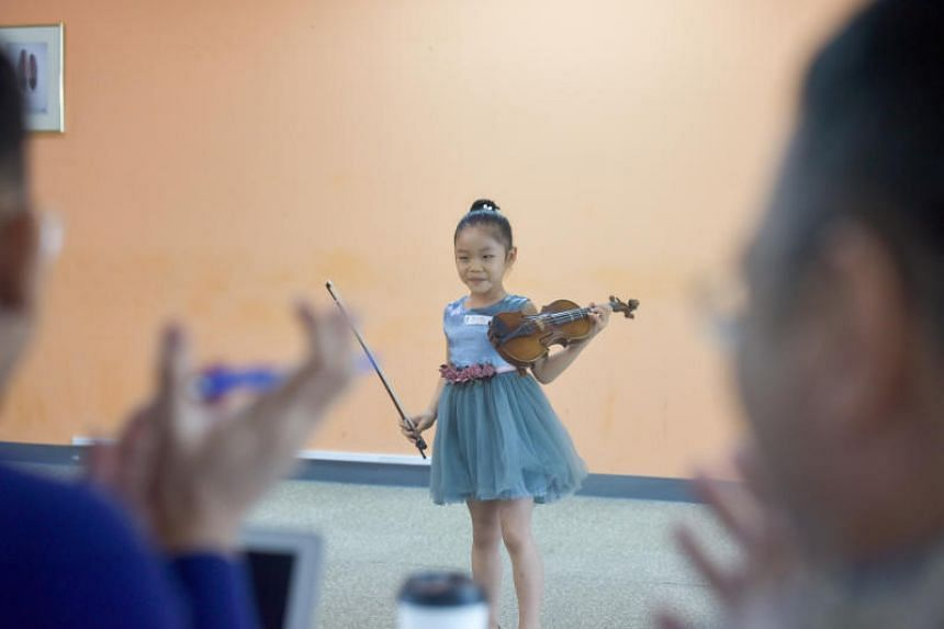 Valerie Ching, six, auditioning for the ChildAid concert at the Singapore Press Holdings News Centre on July 29, 2018.